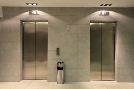 Two lifts in a hotel hall Stock Photo