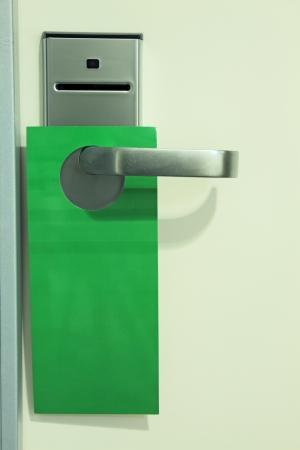 hotel door: Hotel door with the tablet hanging on it