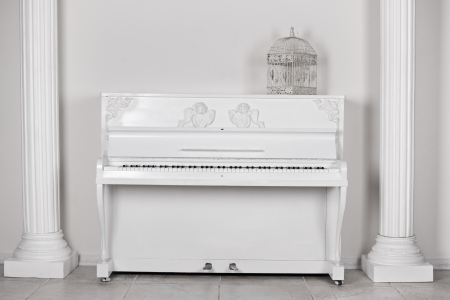White room with columns and the piano about a wall photo