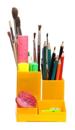 Case about many multi-colored pencils, felt-tip pens, brushes, isolated on a white background photo