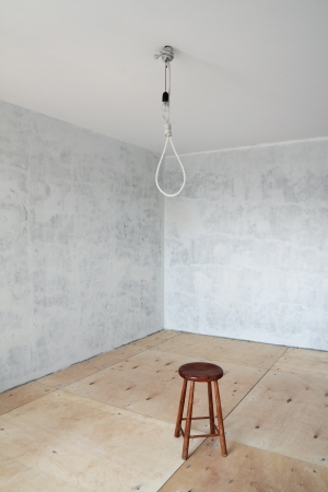 indigence: Empty room with grey walls during repair and the gallows on a ceiling