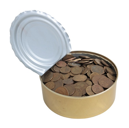 The can filled with old coins, isolated on a white background