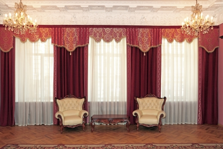 The big magnificent room with red curtains and period furniture Stock Photo - 22063973