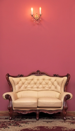leathern: Old antiquarian sofa about a wall Stock Photo