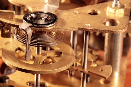 The mechanism of an old bracket clock photo