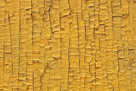 Yellow structure of the old cracked paint Imagens