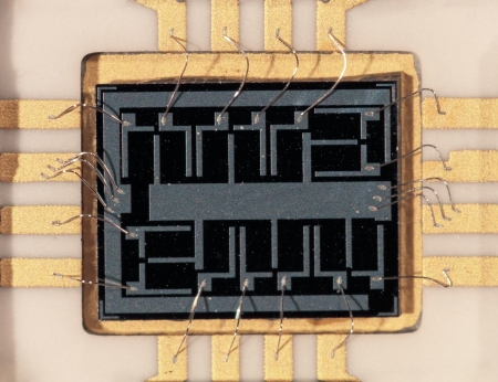 Microcircuit crystal the size 4x3mm, close up at substantial magnification photo