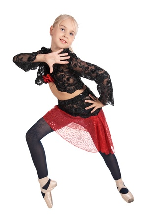 The girl in a red and black dancing suit, is isolated on a white background