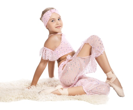 frock coat: The girl in a pink dancing suit, is isolated on a white background Stock Photo