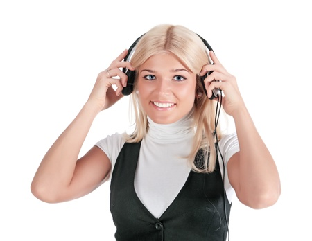 seventh: The happy girl in ear-phones, isolated on a white background Stock Photo