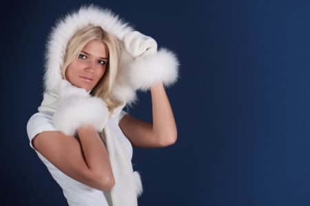 Portrait of the fine girl in winter fur clothes photo