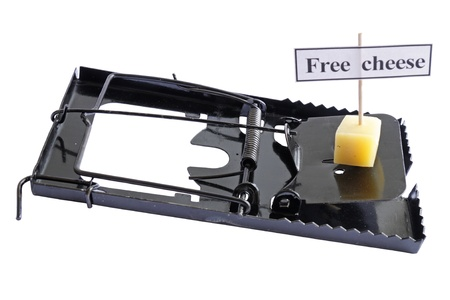 Metal mousetrap with cheese isolated on a white background