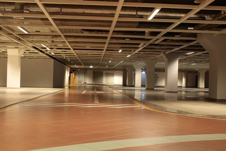 Empty parking of cars in an underground floor of office building