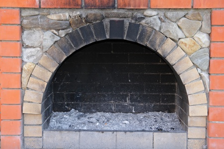 soot: The small brick furnace and soot in it