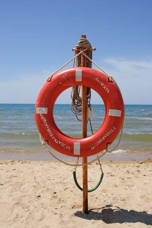 Life buoy on a beach against the sea Stock Photo