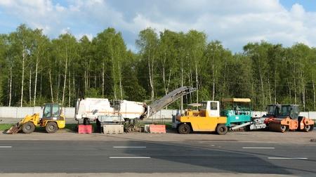 roadside stand: Road repair machines stand on the roadside