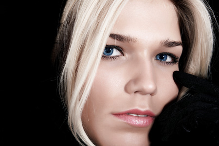 deplorable: Portrait of the fine blonde, close up on a black background Stock Photo