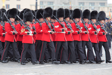 disperse: MOSCOW - MAY 6: Soldiers participate in a review dress rehearsal on May 6, 2010 in Moscow. Soldiers disperse after parade. The British royal grenadiers. The rehearsal is to celebrate the upcoming 65th Anniversary of Victory Day (WWII) on May 9th. Editorial