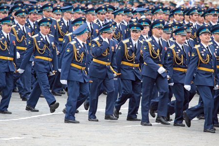 disperse: MOSCOW - MAY 6: Soldiers participate in a review dress rehearsal on May 6, 2010 in Moscow. Soldiers disperse after parade. The rehearsal is to celebrate the upcoming 65th Anniversary of Victory Day (WWII) on May 9th.