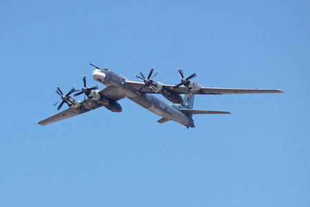 MOSCOW - MAY 9: Military parade of 65th anniversaries of a victory devoted to celebrating in WWII, on May 9, 2010 in Moscow. The Tupolev Tu-95 (Bear) is a large, four-engine turboprop powered strategic bomber and missile platform in the sky over Moscow fl