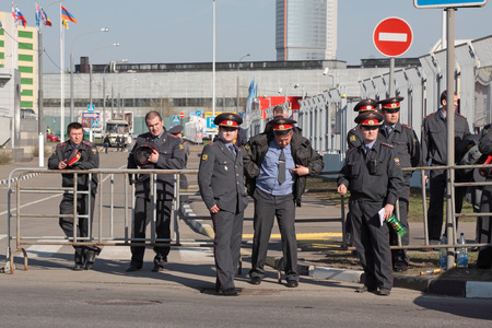 A group of police officers providing security an important event in the street in Moscow