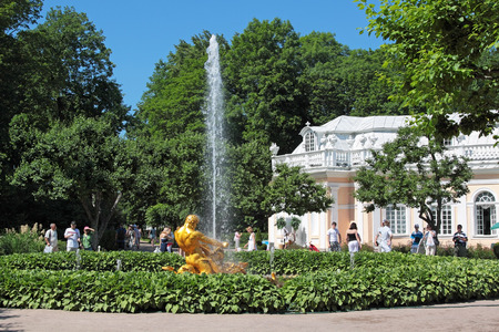 architectonics: ST. PETERSBURG, RUSSIA - JUL 02:Tourists visiting the sights of the lower park of Peterhof on Jul 02, 2011 in St. Petersburg, Russia. After the solemn opening of the fountains this place is visited daily by thousands of tourists. Editorial