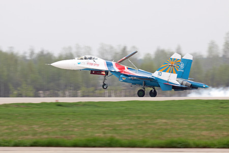 aerodrome: MOSCOW - MAY 06: Celebrations of the 20th anniversary of the flight groups Strizhi and Russian Knights (Russkie Vityazi) on aerodrome Kubinka on May 6, 2011 in Moscow, Russia. Landing SU-27