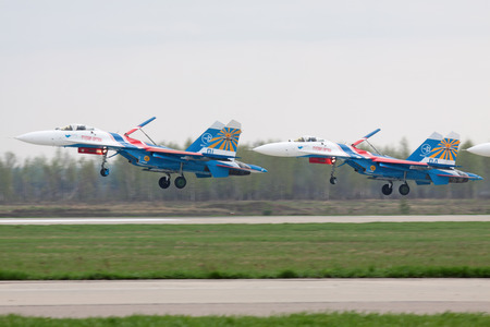aerodrome: MOSCOW - MAY 06: Celebrations of the 20th anniversary of the flight groups Strizhi and Russian Knights (Russkie Vityazi) on aerodrome Kubinka on May 6, 2011 in Moscow, Russia. Simultaneous landing of three Su-27 fighters Editorial