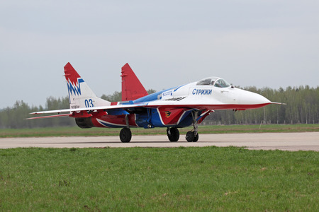 landing strip: MOSCOW - MAY 06: Celebrations of the 20th anniversary of the flight groups Strizhi and Russian Knights (Russkie Vityazi) on aerodrome Kubinka on May 6, 2011 in Moscow, Russia. Mig-29 was taxiing on the runway landing strip Editorial