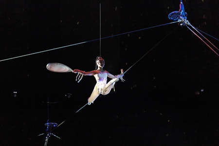 MOSCOW, RUSSIA - NOVEMBER 27: The presentation of the Golden Buff. A woman under a dome of a tightrope walker of the Moscow State Circus on November 27, 2011 in Moscow, Russia