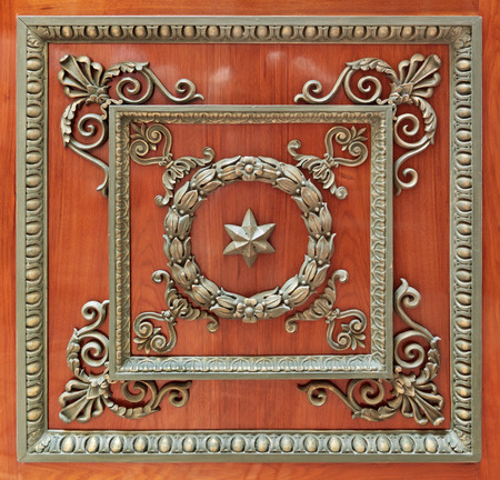 smithery: Antique ornate metal decoration on the wooden background