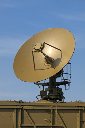 The military aerial of a radar against the blue sky Stock Photo