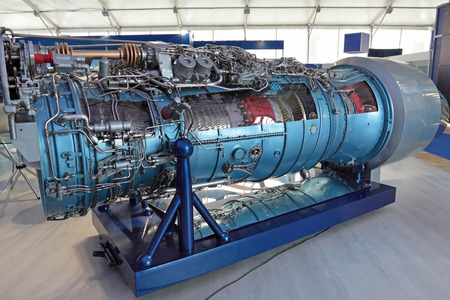 Model of gas turbine engine airplane in the section Stock Photo