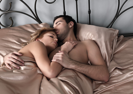 sex love: The girl and the guy sleep in a bed