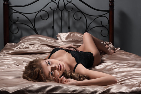 black sex: The sexy girl lies on a bed Stock Photo