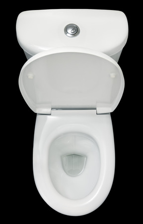 White toilet bowl, isolated on black background, top view photo