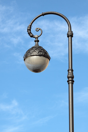 Beautiful decorative lamp post on the background of blue sky