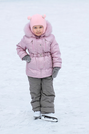 utmost: The five years girl with the childrens fads in winter clothes on a skating rink to the utmost