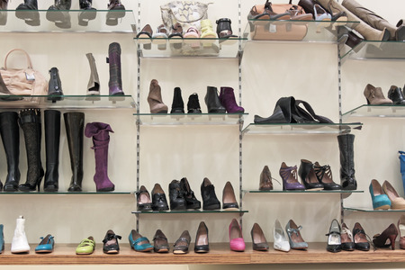 Counter with female shoes in shoe shop photo