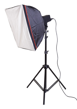 The studio lighter with softbox on a tripod, isolated on a white background photo
