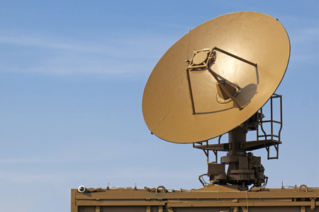intercommunication: The military aerial of a radar against the blue sky Stock Photo