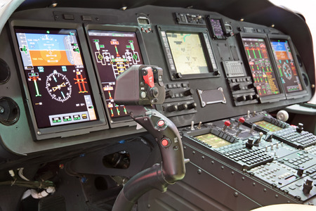 Interior of the modern helicopter and handle control photo