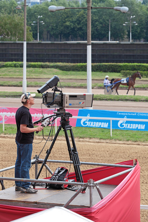 MOSCOW, RUSSIA - JUL 07: The races for the prize of the President of the Russian Federation on Jul 07, 2012 in Moscow. A professional videographer at work