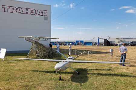 distantly: ZHUKOVSKY, RUSSIA - AUG 11: The opening ceremony of celebrating of the 100 anniversary of Russian air force. August, 11, 2012 at Zhukovsky, Russia. The Unmanned aerial vehicles (UAV) the production of Transas Editorial