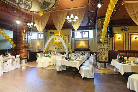 The interior of the restaurant with a laid tables, nobody
