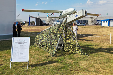 distantly: ZHUKOVSKY, RUSSIA � AUG 11: The opening ceremony of celebrating of the 100 anniversary of Russian air force. August, 11, 2012 at Zhukovsky, Russia. The Unmanned aerial vehicles (UAV) Filin-2, Eagle-owl-2, designed for the needs of the emergency Ministry Editorial
