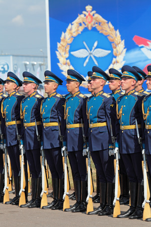ZHUKOVSKY, RUSSIA - AUG 11: The celebrating of the 100 anniversary of Russian air force. August, 11, 2012 at Zhukovsky, Russia. A battalion of the guard of honour of the commandant of the regiment of the air force of Russia meets with the President of Rus