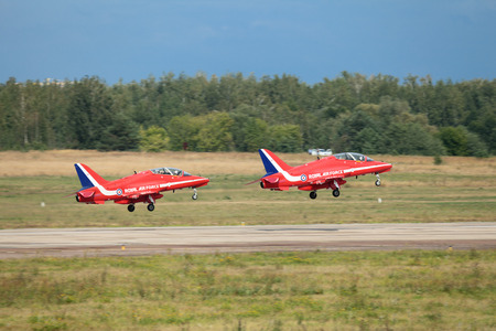 royal air force: ZHUKOVSKY, RUSSIA � AUG 11: The opening ceremony of celebrating of the 100 anniversary of Russian air force. August, 11, 2012 at Zhukovsky, Russia. Aerobatic team Red Arrows Royal Air Force of United Kingdom take off from the airfield Ramenskoe