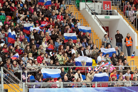 stadia: MOSCOW, RUSSIA - APR 28: Palace of sports Megasport. The spectators in the bleachers watching a performance at the World championship on figure skating on April 28, 2011 in Moscow.