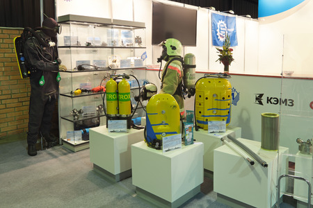 respiratory apparatus: ZHUKOVSKY, RUSSIA - JUN 29: The international salon of arms and military technology Engineering technologies 2012 on Jun 29, 2012 in Zhukovsky. Costumes for under water and for the extinguishing of fires Editorial